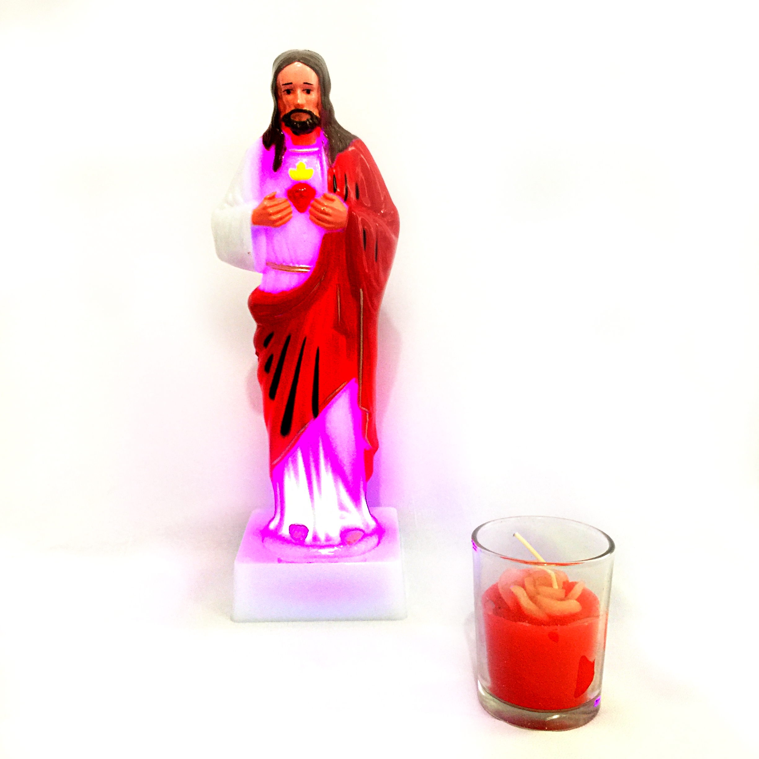 Jesus Statue with Candle